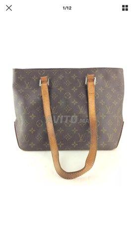 35d2123f0fe5 Authentique Louis Vuitton Mng Cabas Piano M51148 à vendre à Tétouan ...